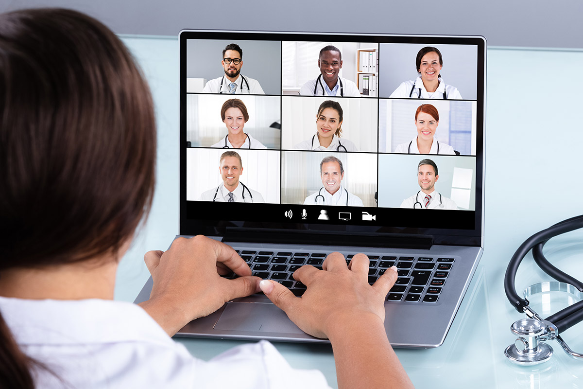 Doctor In Online Medical Video Conference With Diverse Team Of Hospital Workers